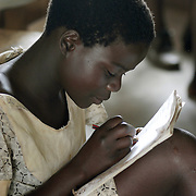 Shewula, Swaziland                     October, 2004..A learner takes notes  in class at a non-formal school in the Shewula district October 18, 2004.The schools are built and supported by international NGO's to educate AIDS orphans who would not be able to pay school fees. Photo by Lori Waselchuk/South Photographs
