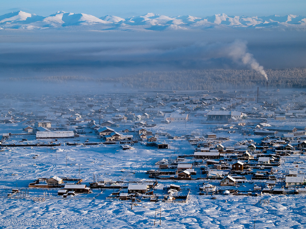 The Pole of Cold - Tomtor village seen from a nearby mountain. The area is extremely cold during the winter. Two towns by the highway, Tomtor and Oymyakon, both claim the coldest inhabited place on earth (often referred to as -71.2∞C, but might be -67.7∞C) outside of Antarctica. The average temperature in Oymyakon in January is -42∞C (daily maximum) and -50∞C (daily minimum). The images had been made during an outside temperature in between -50∞C up to -55∞C. Tomtor, Jakutien , Yakutia, Russian Federation, Russia, RUS, 19.01.2010