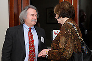 Bob Yeck of Yeck Brothers Company (left) and Joanie Spain of school of advertising art during the holiday meeting of the American Advertising Federation at the NCR Country Club in Kettering, Thursday, December 15, 2011.