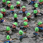 COMPETITORS AT THE START OF THE SWIMING SECTION THIS WEEKEND  AT THE LONDON TRIATHLON...The Royal Docks became the focus of the triathlon world this  weekend as thousands of competitors took part in one of the sport's showpiece events...The Mazda London Triathlon takes place over the weekend of August 1-2 with some of the world's best in action, including  Formula One racing driver Jenson Button... The Mazda London triathlon, centred around the ExCeL centre, is the largest event of its kind in the world.