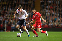 BIRMINGHAM, ENGLAND - Monday, October 13, 2008: Wales' captain Neal Eardley and England's Adam Johnson during the UEFA European Under-21 Championship Play-Off 2nd Leg match at Villa Park. (Photo by Gareth Davies/Propaganda)
