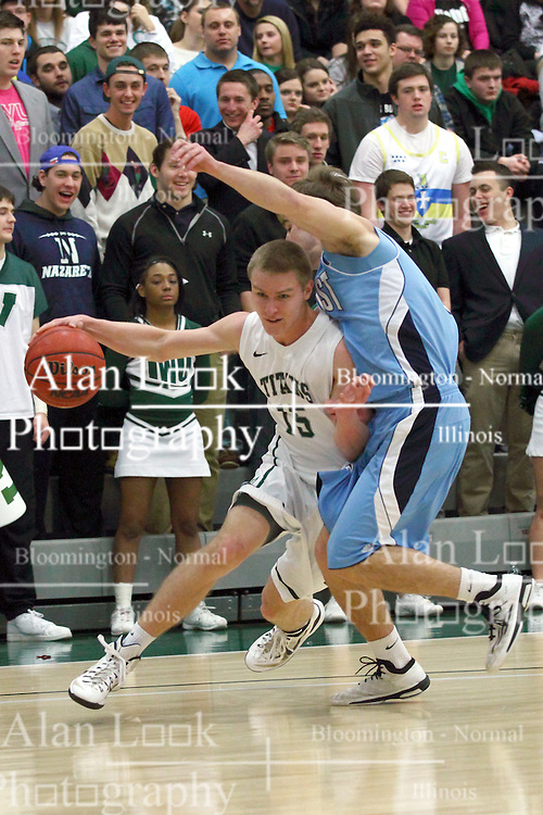21 February 2015:  Brady Rose turns on the base line against Eric Leonard during an NCAA men's division 3 CCIW basketball game between the Elmhurst Bluejays and the Illinois Wesleyan Titans in Shirk Center, Bloomington IL