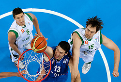 Kosta Perovic of Serbia between Jaka Lakovic of Slovenia and Erazem Lorbek of Slovenia during basketball game between National basketball teams of Slovenia and Serbia in 7th place game of FIBA Europe Eurobasket Lithuania 2011, on September 17, 2011, in Arena Zalgirio, Kaunas, Lithuania. Slovenia defeated Serbia 72 - 68 and placed 7th. (Photo by Vid Ponikvar / Sportida)