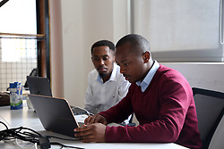 KIGALI, Oct. 30, 2018  The 26-year-old business founder Dioscore Shikama works at a startup hub in Kigali, capital of Rwanda, on Oct. 29, 2018. He set up a target to serve global farmers after participating in a training program for e-commerce business founders provided by China's e-commerce giant Alibaba in China last November. A startup hub on the 4th floor of a commercial building in Rwandan capital city Kigali is where Dioscore Shikama incubates his agri-tech e-commerce company. TO GO WITH Feature: China's e-commerce giant passes on experience to Africa, with potential benefits  djj) (Credit Image: © Lyu Tianran/Xinhua via ZUMA Wire)
