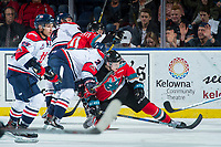 KELOWNA, CANADA - NOVEMBER 17: Calen Addison #2 of the Lethbridge Hurricanes checks Jack Cowell #8 of the Kelowna Rockets during second period on November 17, 2017 at Prospera Place in Kelowna, British Columbia, Canada.  (Photo by Marissa Baecker/Shoot the Breeze)  *** Local Caption ***