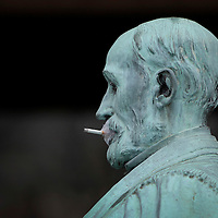 "November 19, 2009 - Lexington, Kentucky, USA - A cigarette slowly burned after it had been taped to the mouth of a statue of the University of Kentucky's first president, JAMES PATTERSON, as students have a ""smoke-out"" to protest the University's tobacco ban on campus which began today. About a hundred student smokers and non-smokers gathered to protest the campus-wide tobacco ban UK implemented Thursday by continuously using tobacco products in front of Patterson Office Tower and on the Student Center patio. The ban prohibits the use of cigarettes, pipes, cigars and chewing tobacco, and extends to all properties owned by the university in Fayette County. (Credit image: © David Stephenson/ZUMA Press)"