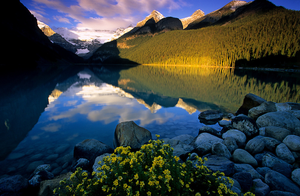 Early morning light illuminates the features around the well known Lake Louise in Banff National Park, Alberta