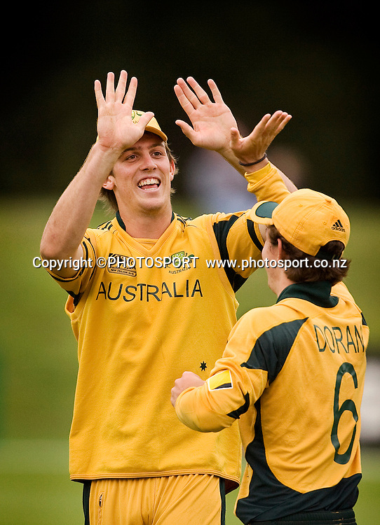 Australian captain Mitchell Marsh celebrates the last wicket with the catcher Luke Doran. New Zealand v Australia, U19 Cricket World Cup Quarter Final, Mainpower Oval, Rangiora, Sunday 24 January 2010. Photo : Joseph Johnson/PHOTOSPORT