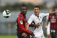 FOOTBALL - FRENCH CHAMPIONSHIP 2010/2011 - L2 - CLERMONT FOOT AUVERGNE v SCO ANGERS - 20/08/2010 - PHOTO ERIC BRETAGNON / DPPI -  BRUCE ABDOULAYE  (CLER) / CLAUDIU KESERU  (ANG)