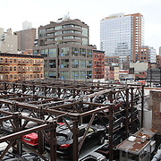 Views from The High Line of stacked commuter Car Parking in Manhattan, New York. The High Line is a 1-mile New York City linear park built on a 1.45-mile section of the former elevated New York Central Railroad spur called the West Side Line, which runs along the lower west side of Manhattan; it has been redesigned and planted as an aerial greenway. New York, USA.  Photo Tim Clayton