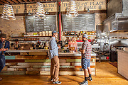 Guys ordering beer at the counter at the Yellow Brick Cafe down town Twin Falls, Idaho.