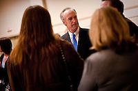 JEROME A. POLLOS/Press...Dirk Kempthorne visits with North Idaho residents following a luncheon he spoke at Thursday in Coeur d'Alene regarding his career in politics.
