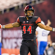 12 October 2018: San Diego State Aztecs linebacker Kyahva Tezino (44) runs off the field after forcing a fumble that was overturned after video review in the first quarter. The San Diego State Aztecs lead 14-9 at the half against the Air Force Falcons at SDCCU Stadium Friday night.