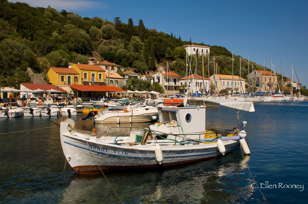 Traditional wooden fishing boats in the harbour at Kioni, Ithaca, The Ionian Islands, Greece