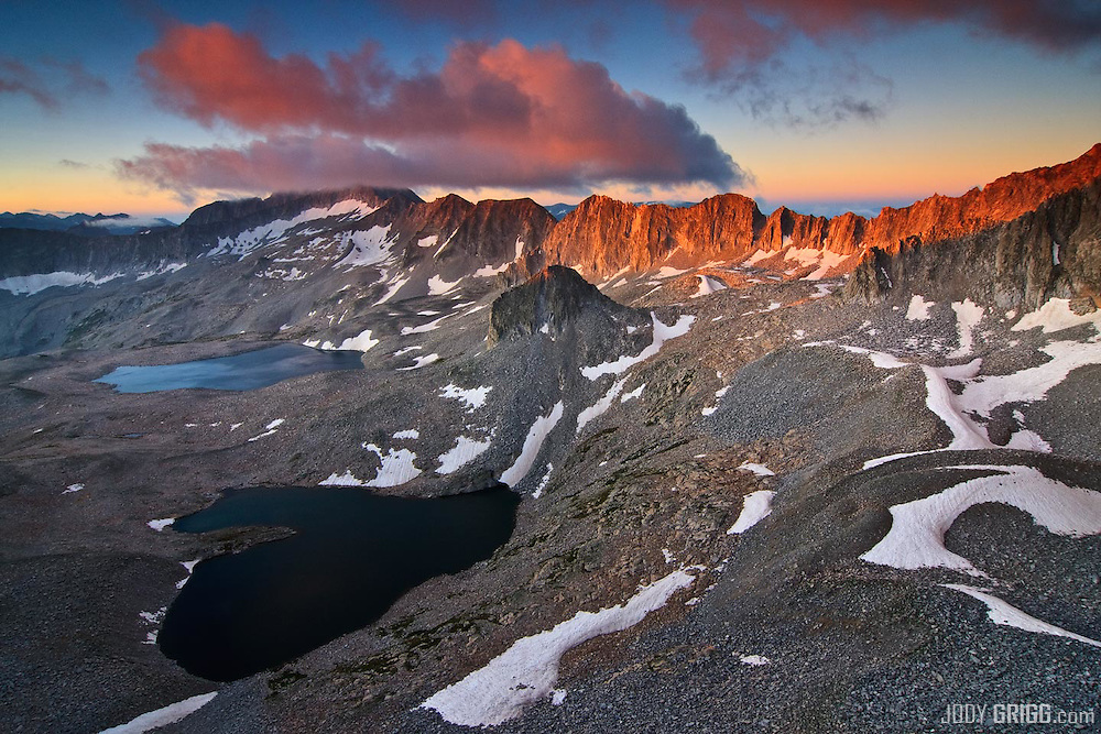A September sunrise on the Pierre Lakes Cirque with colorado fourteener Snowmass Mountain, 14,092ft in the distance shrouded in the clouds.