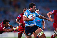 SUPER RUGBY - Dave Dennis gets past Digby Ioane. Images from the round 2 match between the NSW Waratahs and the Queensland Reds. Played at ANZ Stadium, Sydney Olympic Park, Saturday, 26 February 2011. Photo: Murray Wilkinson (SMP Images)
