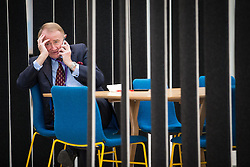 © Licensed to London News Pictures . 14/11/2013 . Manchester , UK . A man in an open office space in the reception of the Co-operative building at 1 Angel Square . Queen Elizabeth II and the Duke of Edinburgh visit the Coop building at 1 Angel Square , Manchester , this morning ( 14th November 2013 ) . Photo credit : Joel Goodman/LNP