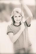 Image of a teenage girl outdoors, Harstine Island, Washington, Pacific Northwest, model released  (toned black & white digital photo-illustration)