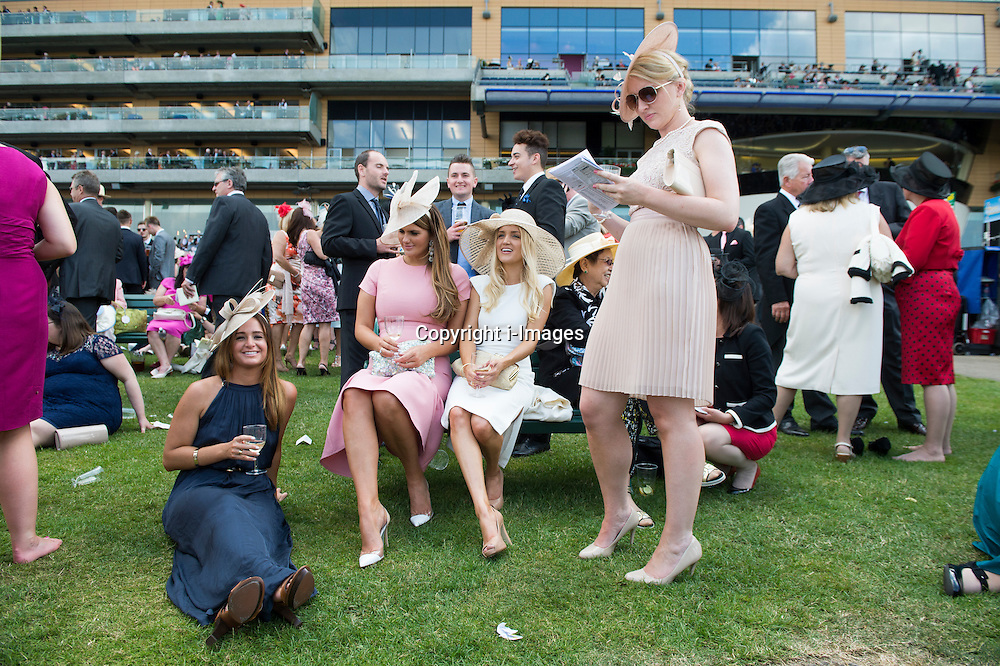 Image licensed to i-Images Picture Agency. 20/06/2014. Ascot, United Kingdom. Racegoers enjoying the weather on day four of Royal Ascot. Picture by i-Images