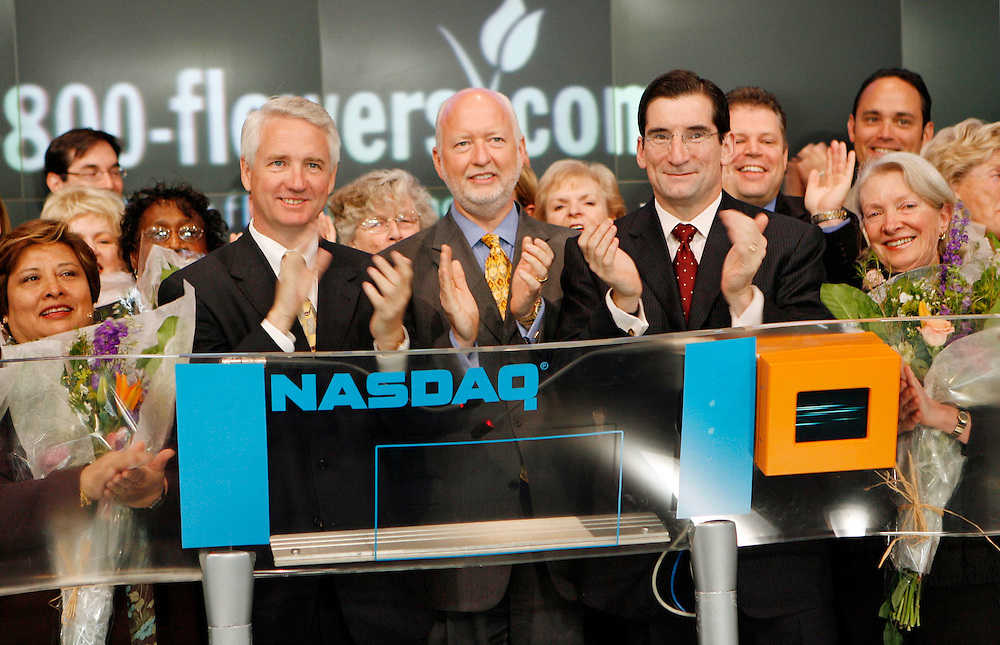 In this handout photo from 1-800-FLOWERS.COM, center left to right, Chris McCann, president, Jim McCann, CEO, of 1-800-FLOWERS.COM, and Bob Greifeld, president and CEO of NASDAQ, are joined by mothers of employees from both organizations as Jim McCann prepares to ring the opening bell at the NASDAQ Marketsite in Times Square, Monday, May 8, 2006. 1-800-FLOWERS.COM celebrates its 30th anniversary and the week of Mother's Day. (Photo/1-800-FLOWERS.COM/Stuart Ramson)