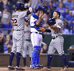 June 8, 2017 - Kansas City, MO, USA - The Houston Astros' Josh Reddick congratulates Jose Altuve in front of Kansas City Royals catcher Drew Butera after Altuve's two-run home run in the ninth inning at Kauffman Stadium in Kansas City, Mo., on Thursday, June 8, 2017. (Credit Image: © John Sleezer/TNS via ZUMA Wire)
