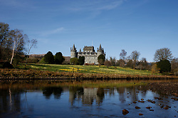 Inveraray Castle in western Scotland, on the shore of Loch Fyne. It has been the seat of the Dukes of Argyll, chiefs of Clan Campbell, since the 18th century. Here bathed in the spring sunshine with the daffodils in full bloom.... (c) Stephen Lawson | Edinburgh Elite media