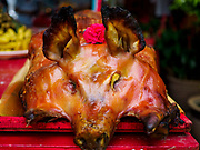 25 AUGUST 2018 - GEORGE TOWN, PENANG, MALAYSIA: A barbecued pig on a family altar on Ghost Day, the full moon day (or night) that falls in the middle of Hungry Ghost month. The Ghost Festival, also known as the Hungry Ghost Festival is a traditional Taoist and Buddhist festival held in Chinese communities throughout Asia. Ghost Day, is on the 15th night of the seventh month (25 August in 2018). During Ghost Festival, the deceased are believed to visit the living. In many Chinese communities, there are Chinese operas and puppet shows and elaborate banquets are staged to appease the ghosts.      PHOTO BY JACK KURTZ