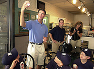 """Baseball Hall of Fame pitcher Jim Palmer (C) shows members of the Leesburg, Virginia Tigers how to throw a curveball, at a luncheon, as part of the Little League World Series festivities, Sunday, August 25, 2002, in Williamsport, Pennsylvania. The Tigers won the """"OxiClean True Grit"""" contest, and their prize was a trip to the Little League World Series, and to meet Jim Palmer. (Photo by William Thomas Cain/photodx.com)"""