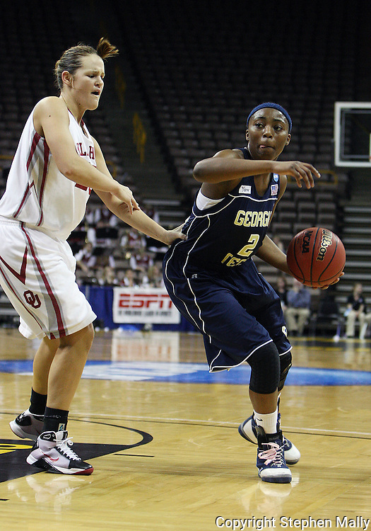 24 MARCH 2009: Georgia Tech guard Mo Bennett (2) drives around Oklahoma guard Whitney Hand (25) during an NCAA Women's Tournament basketball game Tuesday, March 24, 2009, at Carver-Hawkeye Arena in Iowa City, Iowa. Oklahoma defeated Georgia Tech 69-50.
