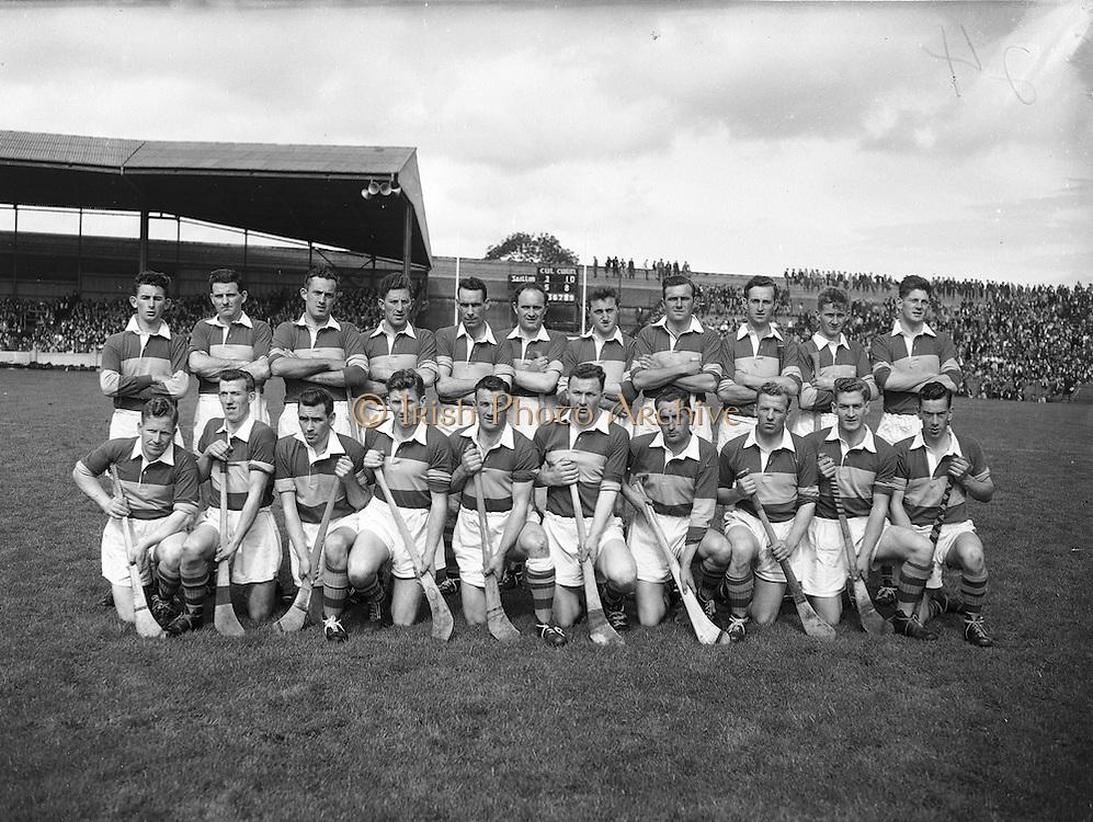 Neg No: .A801/4571-4583,..7091958AISHCF,..07.09.1958, 09.07.1958, 7th September 1958,.All Ireland Senior Hurling Championship - Final,..Tipperary.04-09,.Galway.02-05,.Tipperary Team,.Back row (from left) Noel Murphy, John McGrath, Mick Maher, Kieran Carey, Larry Keane, John Hough, Liam Devaney, John Doyle, Jimmy Finn, Mick Burns, Ray Reidy. Front Row (from left) Martin Maher, Liam Connolly, Jimmy Doyle, Tom Larkin, Theo English, Tony Wall (capt), John O'Grady, Mickey Byrne, Donie Nealon, Terry Moloney,