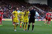 Burton Albion defender John Mousinho (4) discusses foul and penalty with referee Graham Scott during the EFL Sky Bet Championship match between Bristol City and Burton Albion at Ashton Gate, Bristol, England on 4 March 2017. Photo by Richard Holmes.