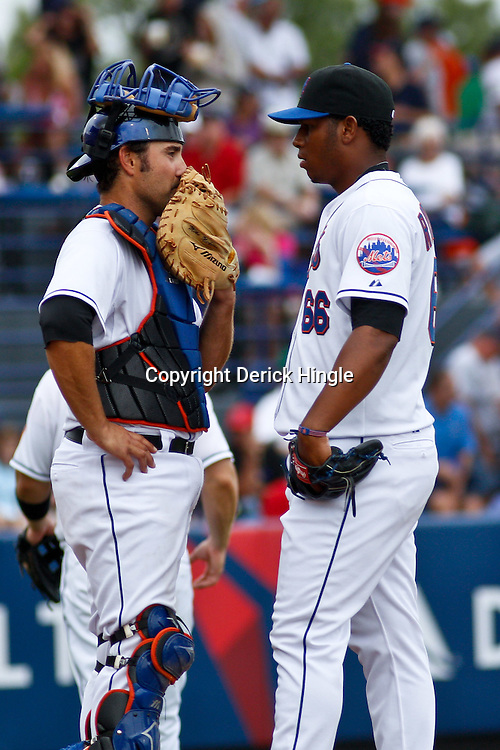 March 6, 2011; Port St. Lucie, FL, USA; New York Mets starting pitcher Armando Rodriguez (66) and New York Mets catcher Mike Nickeas (13) during a spring training exhibition game against the Boston Red Sox at Digital Domain Park.  Mandatory Credit: Derick E. Hingle