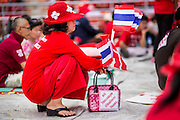 20 NOVEMBER 2013 - BANGKOK, THAILAND:  Thai Red Shirt supporters listen to the Thai Constitutional Court deliver its verdict against the government Wednesday. Thousands of Red Shirts, supporters of the Pheu Thai ruling party in Thailand, gathered in Rajamangala Stadium in suburban Bangkok to listen to the Thai Constitutional Court deliver its verdict against the government. The court ruled that the recent efforts by the government to pass a blanket amnesty bill violated the Thai Constitution but the court did not order the party to disband or the dissolution of the government, which had been widely feared.    PHOTO BY JACK KURTZ