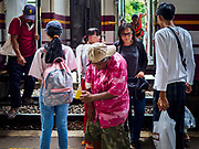 10 JULY 2018 - NAKHON PATHOM, THAILAND:  People get off a train in the station in Nakhon Pathom. Nakhon Pathom is about 35 miles west of Bangkok. It is one of the oldest cities in Thailand, archeological evidence suggests there was a settlement on the site of present Nakhon Pathom in the 6th century CE, centuries before the Siamese empires existed. The city is widely considered the first Buddhist community in Thailand and the nearly 400 foot tall Phra Pathom Chedi is considered the first Buddhist temple in Thailand.    PHOTO BY JACK KURTZ