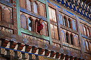 Monk poking his head out of window at Wangdicholing Palace, Bumthang