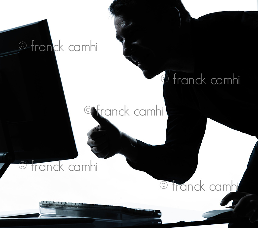 one caucasian business man computing computer thumb up satisfied portrait silhouette in studio isolated on white background