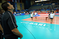 Puerto Rico head coach Jose Mieles listens to his national anthem