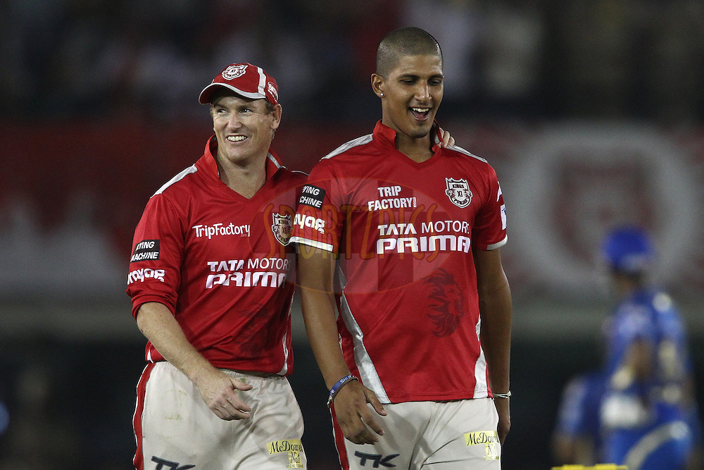 George Bailey captain of the Kings XI Punjab congratulates Beuran Hendricks of the Kings XI Punjab for getting Rohit Sharma captain of of the Mumbai Indians wicket during match 48 of the Pepsi Indian Premier League Season 2014 between the Kings XI Punjab and the Mumbai Indians held at the Punjab Cricket Association Stadium, Mohali, India on the 21st May  2014<br /> <br /> Photo by Shaun Roy / IPL / SPORTZPICS<br /> <br /> <br /> <br /> Image use subject to terms and conditions which can be found here:  http://sportzpics.photoshelter.com/gallery/Pepsi-IPL-Image-terms-and-conditions/G00004VW1IVJ.gB0/C0000TScjhBM6ikg
