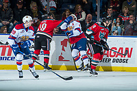 KELOWNA, CANADA - NOVEMBER 14: Dillon Dube #19 of the Kelowna Rockets gets in the face of Will Warm #4 of the Edmonton Oil Kings during first period on November 14, 2017 at Prospera Place in Kelowna, British Columbia, Canada.  (Photo by Marissa Baecker/Shoot the Breeze)  *** Local Caption ***