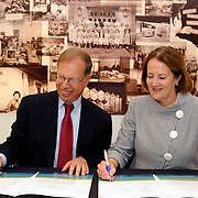 In New York City, Stanley Litow (left), President of the IBM International Foundation and Small Business Administration (SBA) Administrator Karen Mills (right) sign an agreement to launch Supplier Connection, a free web site that makes it easier for 50,000 small U.S. businesses to sell their goods and services to large companies. The new program, which allows small firms to tap the $300 billion that 15 large corporations spend annually with vendors, was created and maintained by IBM through a $10 million grant from the IBM International Foundation. Small firms employ half of all private sector employees, making them vital to growing the U.S. economy and creating jobs. (Feature Photo Service)