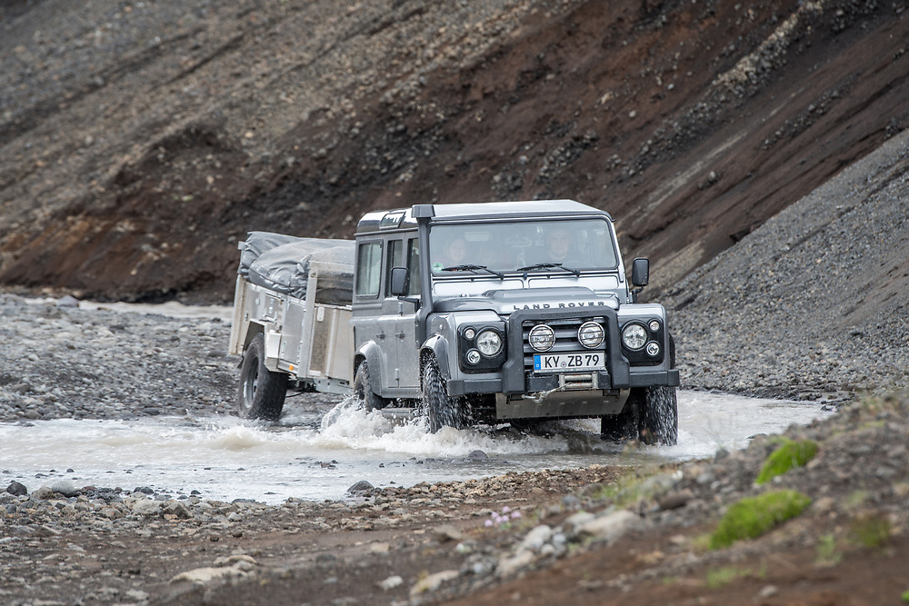 Iceland - Land Rover crossing stream fed by Nýifoss waterfall from lake Hagavatna fed by glacier Langjokull