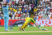 Steve Smith of Australia dives over his crease to avoid a run out during the ICC Cricket World Cup 2019 semi final match between Australia and England at Edgbaston, Birmingham, United Kingdom on 11 July 2019.