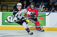 KELOWNA, CANADA - MARCH 15: Mitchell Wheaton #6 of the Kelowna Rockets checks Trent Lofthouse #25 of the Vancouver Giants as he calls for the puck on March 15, 2014 at Prospera Place in Kelowna, British Columbia, Canada.   (Photo by Marissa Baecker/Getty Images)  *** Local Caption *** Mitchell Wheaton; Trent Lofthouse;