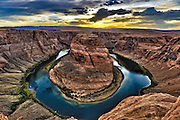 "Horseshoe Bend is the name for a horseshoe-shaped meander of the Colorado River located near the town of Page, Arizona. The bend is locally known as ""King Bend."" It is located slightly downstream from the Glen Canyon Dam and Lake Powell within Glen Canyon National Recreation Area, about four miles south of Page. Accessible via a ¾-mile hike from U.S. Route 89, it can be viewed from the steep cliff above. According to Google terrain maps, the overlook is 4,200 feet above sea level and the Colorado River is at 3,200 feet above sea level making it a breathtaking 1,000 foot drop."