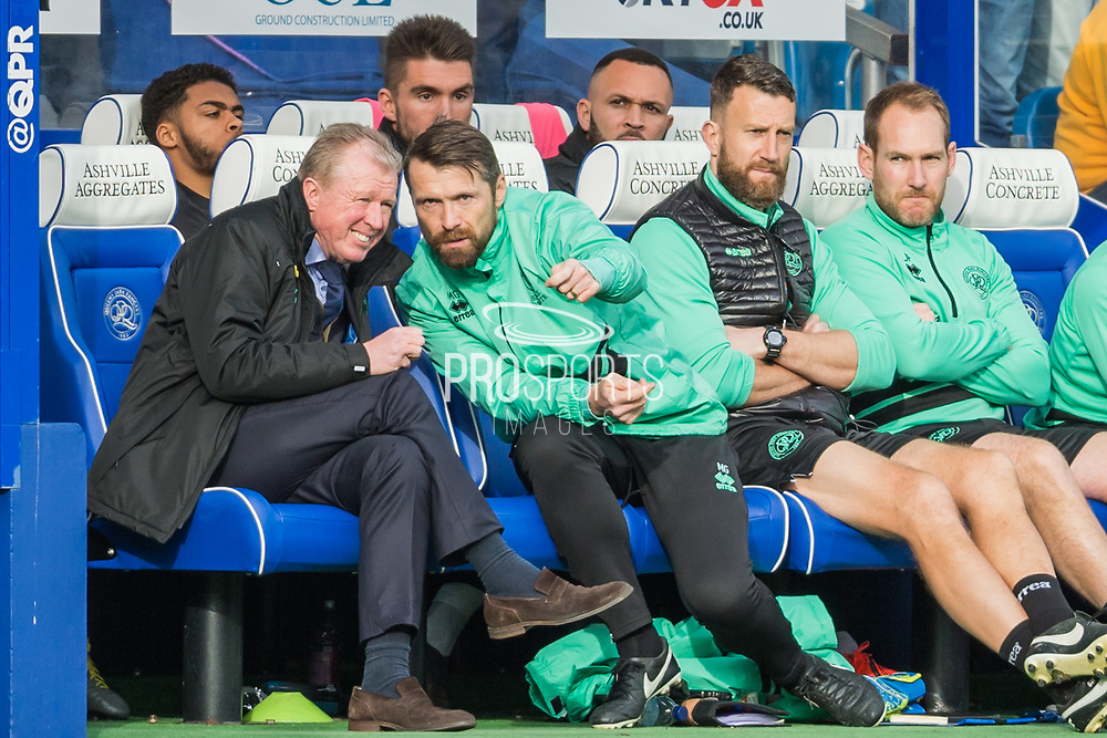 Steve McClaren, Manager of Queens Park Rangers FC & Matt Gardiner, Assistant Coach talking together during the EFL Sky Bet Championship match between Queens Park Rangers and Stoke City at the Loftus Road Stadium, London, England on 9 March 2019.