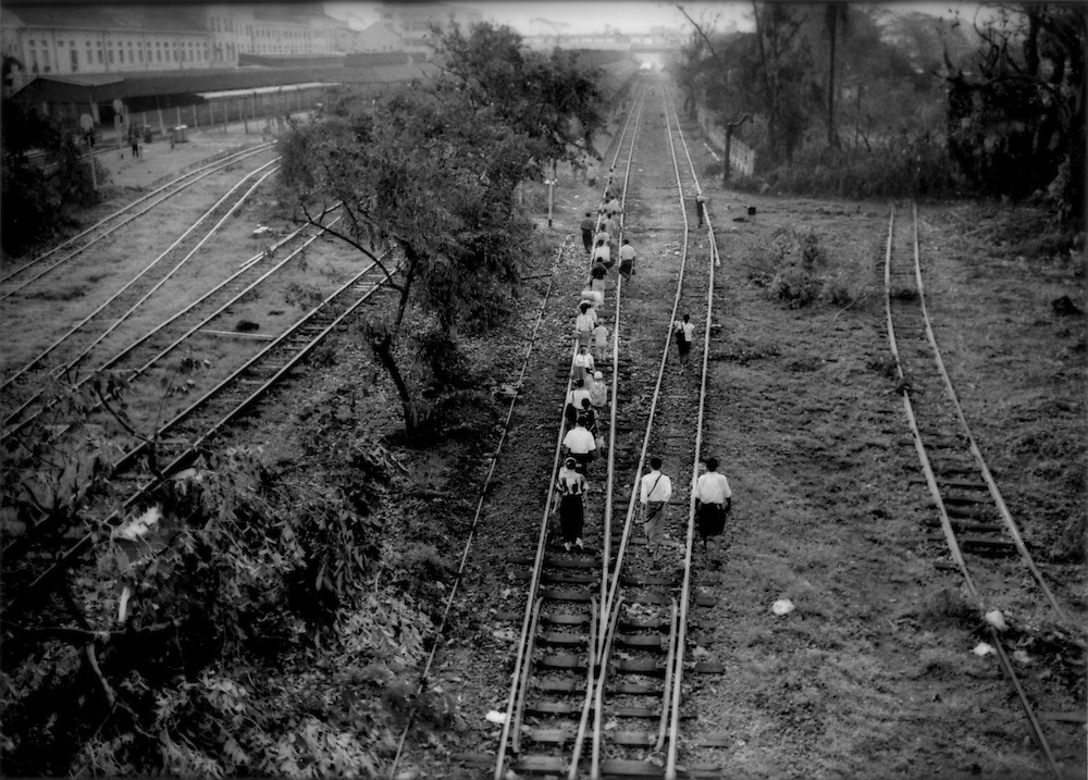 Yangon residents commute by walking the tracks after Cyclone Nargis knocked out train service, Burma (Myanmar).