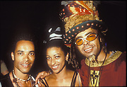 Three black clubbers dressed in tribal gear, Ibiza 1998