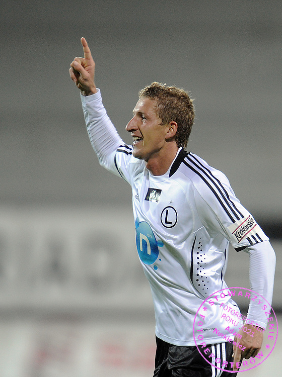 BARTLOMIEJ GRZELAK (LEGIA) CELEBRATES SCORED GOAL FOR LEGIA DURING EXTRALEAGUE SOCCER MATCH BETWEEN LEGIA WARSAW AND LECH POZNAN DURING 8. ROUND SEASON 2009/2010...WARSAW , POLAND , SEPTEMBER 25, 2009..( PHOTO BY ADAM NURKIEWICZ / MEDIASPORT )..PICTURE ALSO AVAIBLE IN RAW OR TIFF FORMAT ON SPECIAL REQUEST.