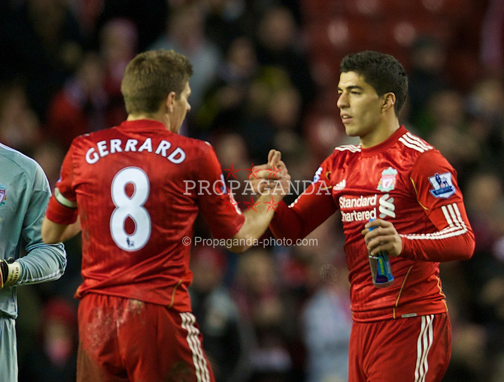 LIVERPOOL, ENGLAND - Wednesday, February 2, 2011: Liverpool's new signing Luis Suarez with captain Steven Gerrard MBE after his side's 2-0 victory over Stoke City during the Premiership match at Anfield. (Photo by David Rawcliffe/Propaganda)