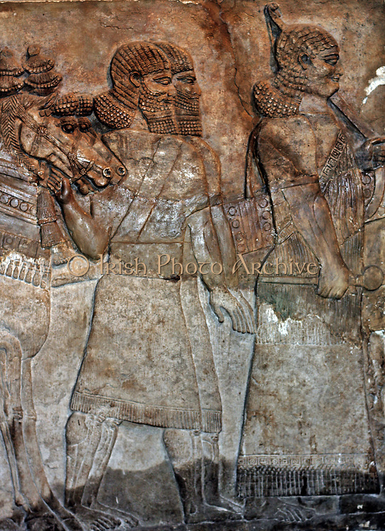 Assyrian wall panel, dated approximately 728 BC depicting the royal chariot. From the Central Palace in Nimrud.
